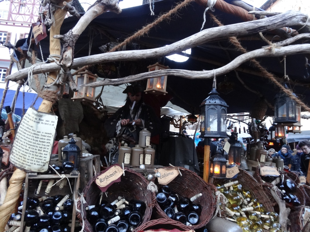 Jack Sparrow and his medieval booth selling I-don't-know-what.