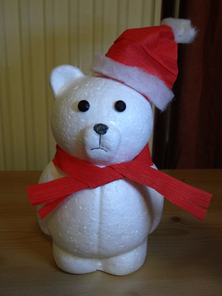 Woolworth (the cheapest store that has basically everything here in Heidelberg) is closing :( They were having a big sale and I got the polar bear figure for 1 euro, then I just gave him a face and something to wear, and now he's a not-so-happy Christmas bear.