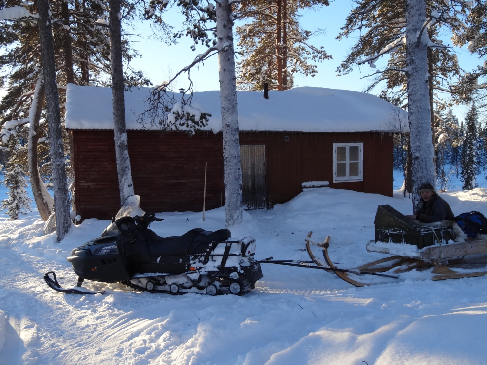 Cabin, snowmobile and our talented cook Mika